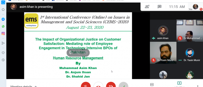 Presenter Presents Research Paper in the 1st International Conference